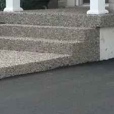 Porch steps and paved driveway